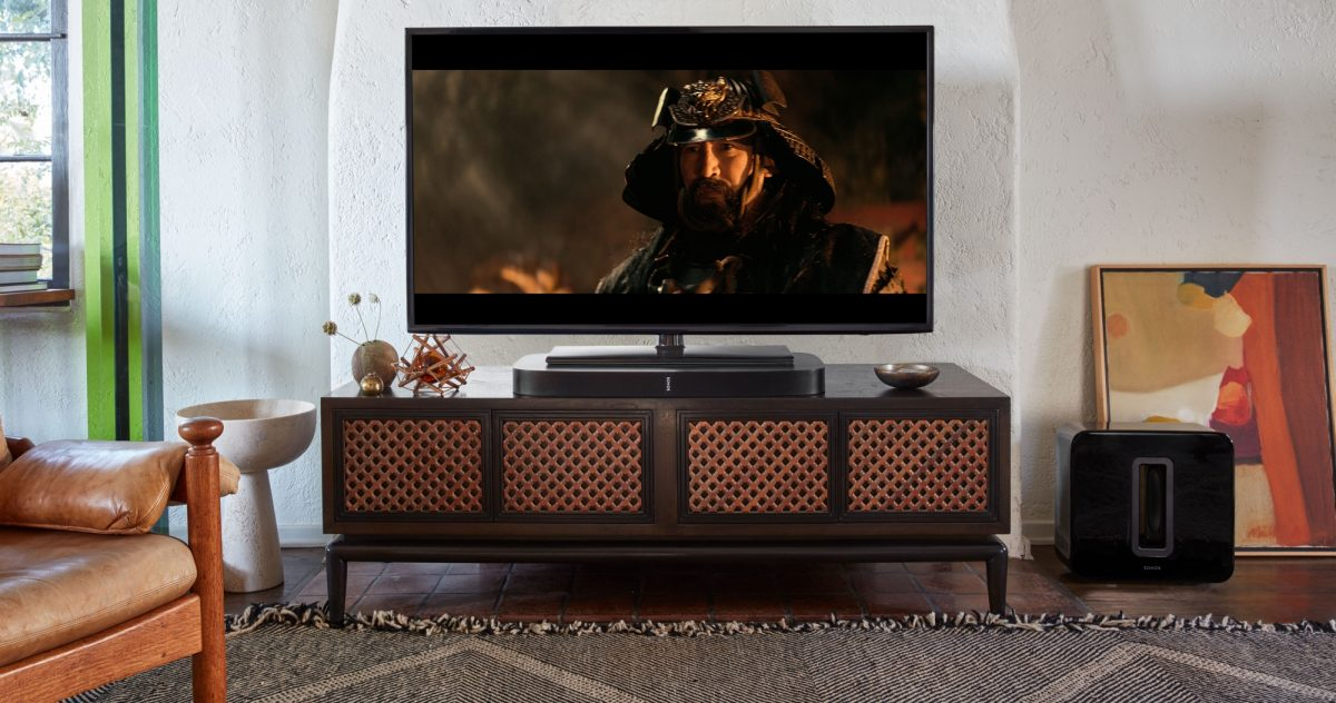 Black Sonos PLAYBASE underneath TV with movie playing