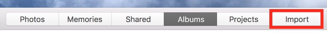 Use iPhoto's Import Tab to stop your the app from launching when you connect your iPhone to your Mac