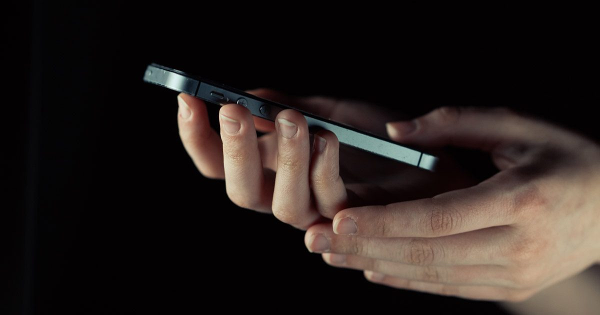 An iPhone being used in the dark