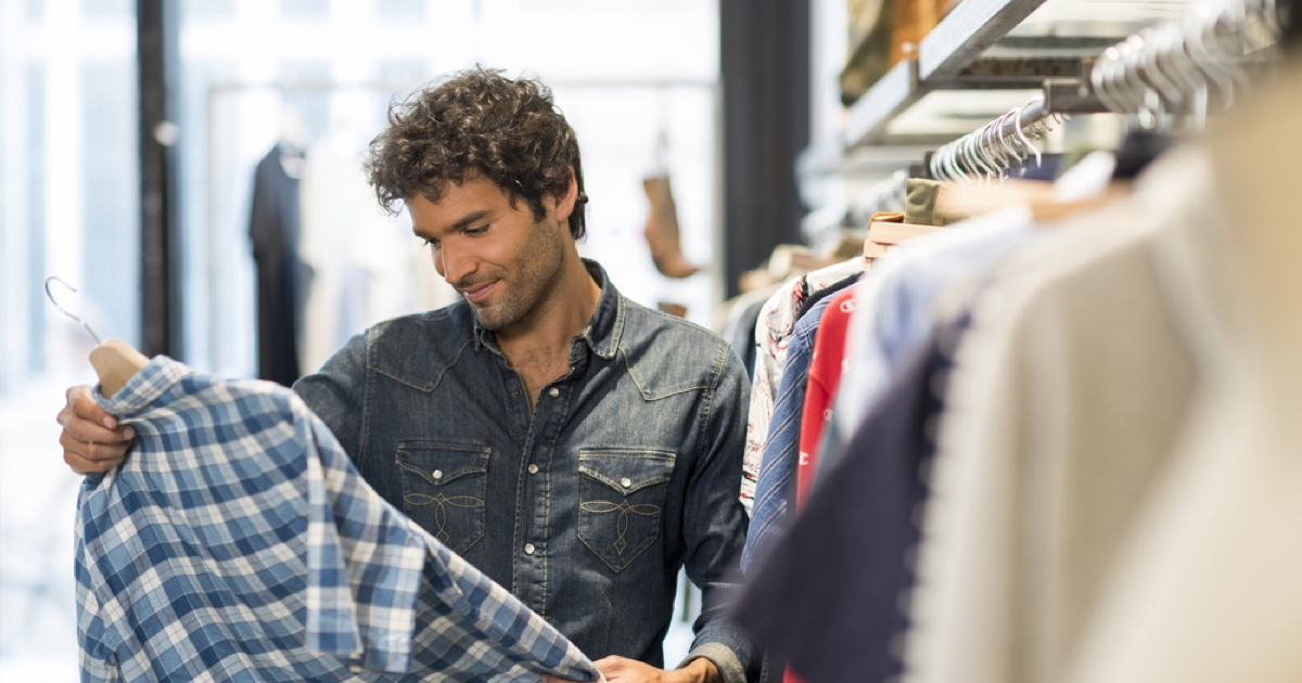 young man shopping for a shirt.