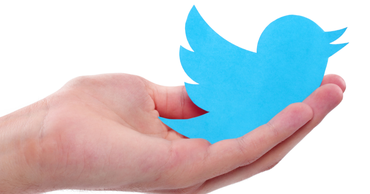 Image of Twitter logo in person's hand. Twitter is effectively killing third party Twitter apps.