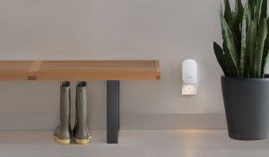 eero Beacon plugged into an outlet with nightlight on