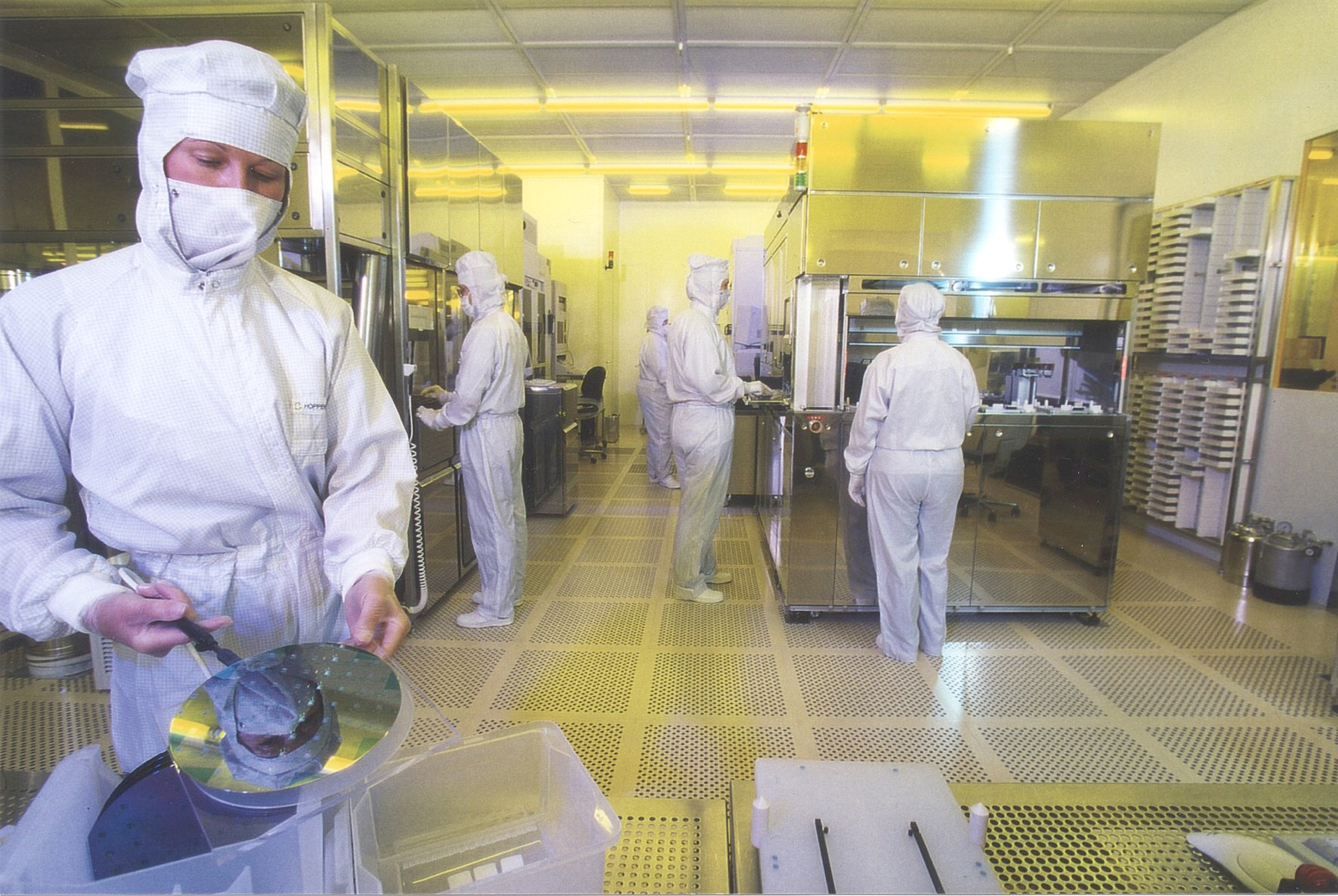 Image of workers in chip supply manufacturing.