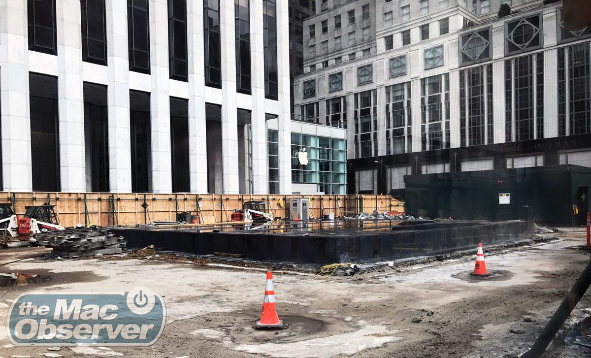 Shot from the north; the black tarp covers where the glass cube used to stand, and behind that you see the temporary apple store front where the old FAO Schwarz toy store used to reside.