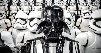 Darth Vader enjoys his Apple Earpods