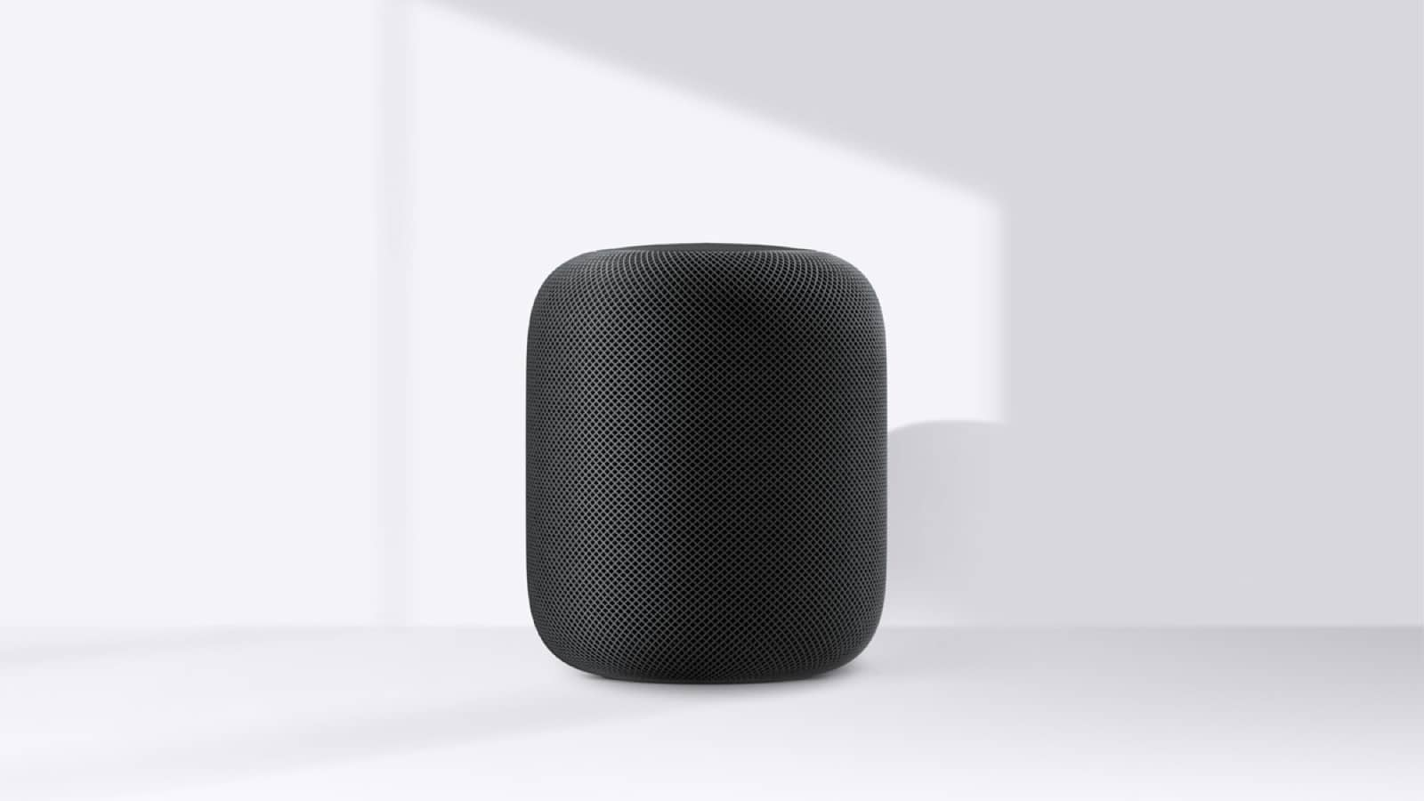 Image of black HomePod. At launch the HomePod language settings for Siri will be English-only for now.