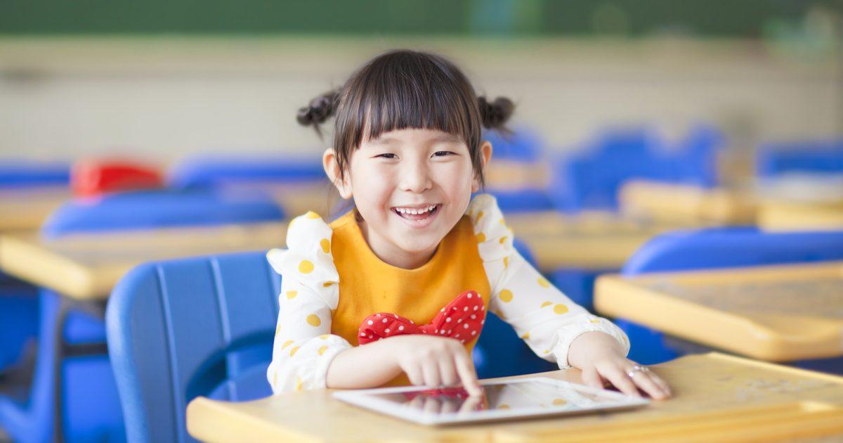 iPads in education - girl in classroom with an iPad