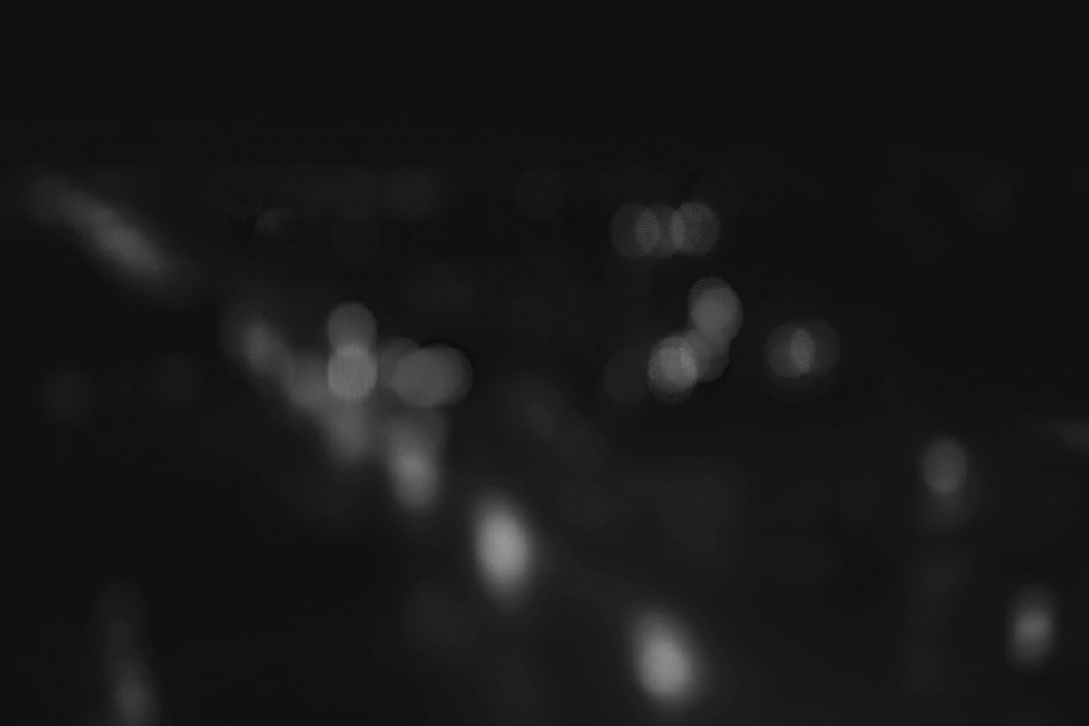 Doing Portrait Mode photography by blurring city lights.