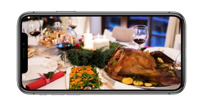 iPhone X with holiday table setting
