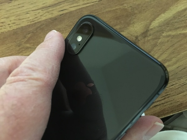 Holding the iPhone X.