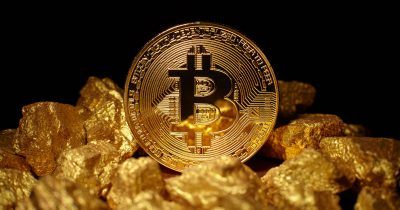 Bitcoin sitting on gold nuggets