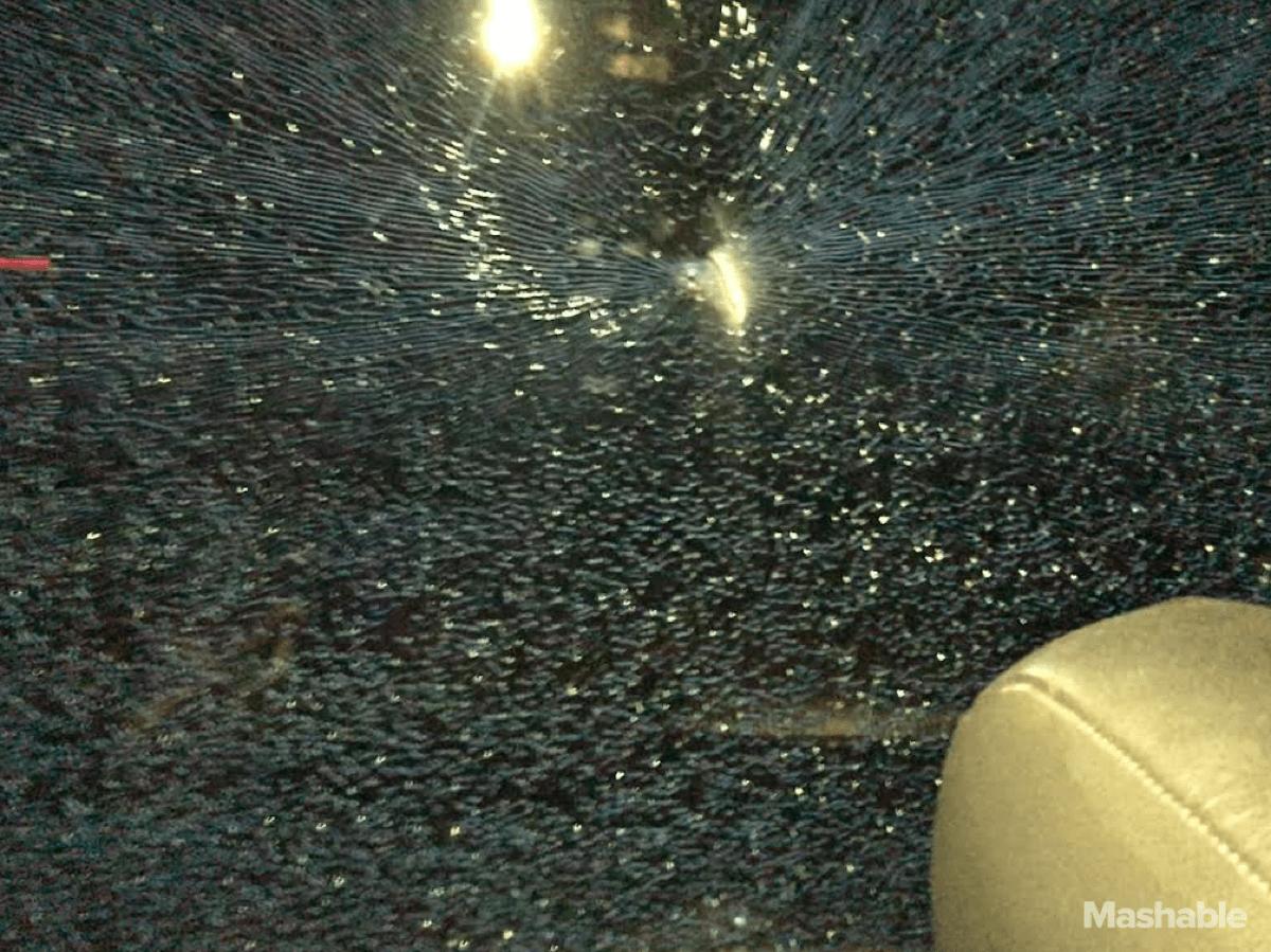One of the broken windows on Apple employee buses.