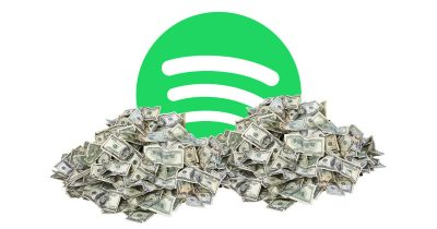 Spotify in a big pile of money