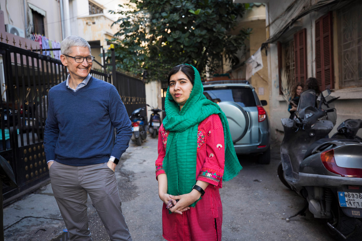 Tim Cook and Malala Yousafzai outside the home of a family with daughters attending school in Beirut