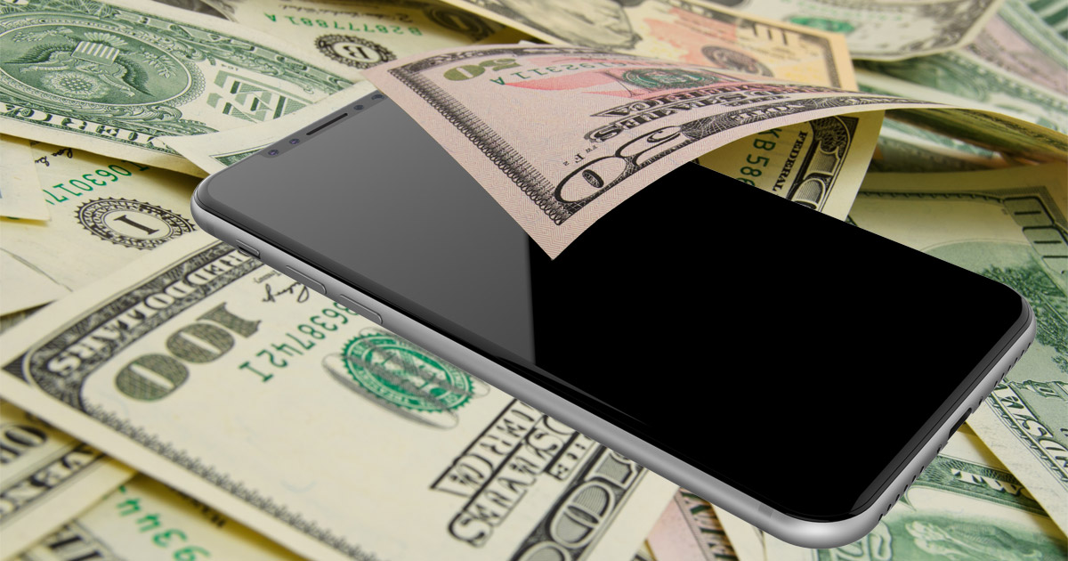iPhone X in a pile of money