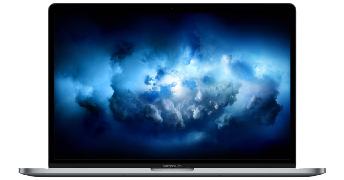MacBook Pro with blue cloud desktop wallpaper