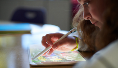A child working with iPad and Pencil