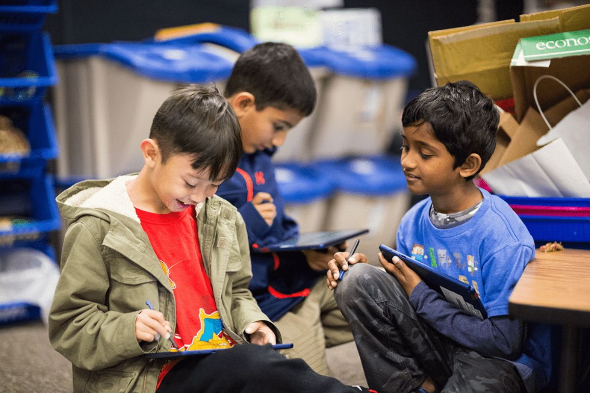 Image of kids using a new Chrome OS tablet, which competes with the education iPad model.