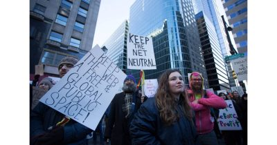 Protesters marching to protect net neutrality