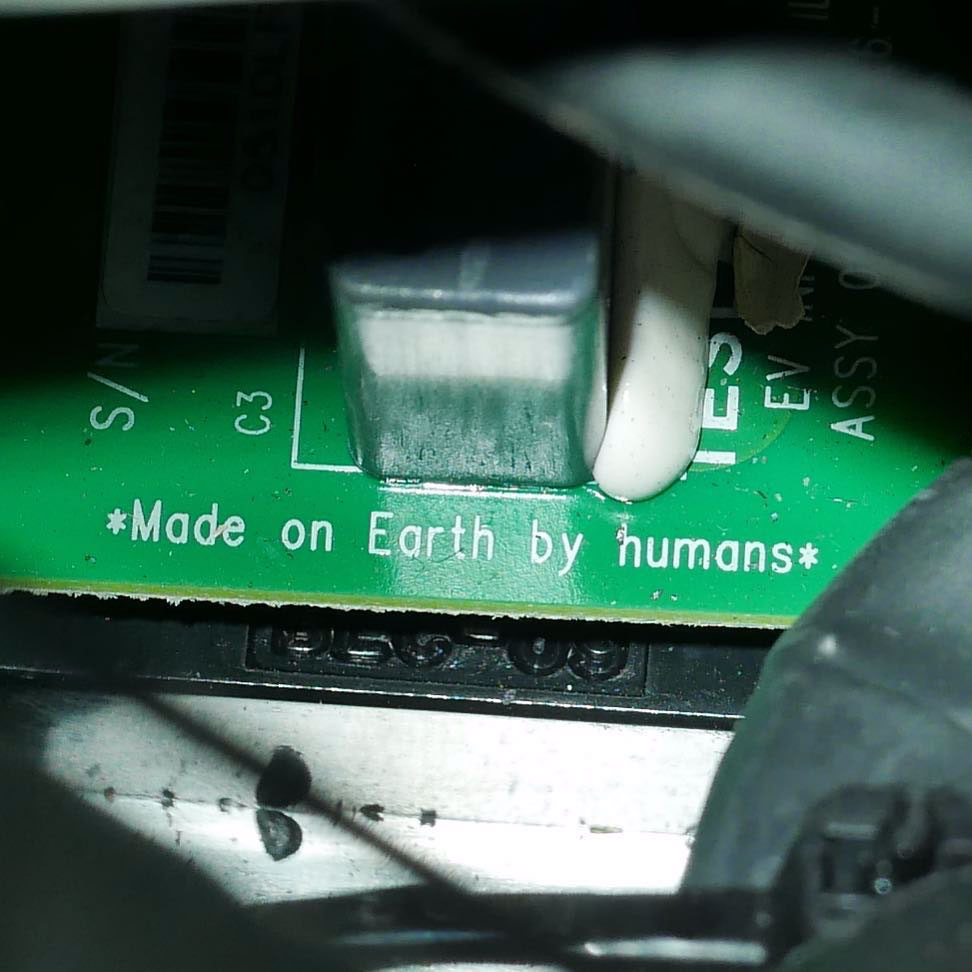 "a circuit board headed to Mars, ""Made on Earth by Humans"""