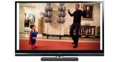President Barak Obama and little boy Superman
