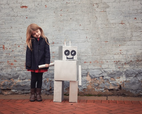 Little girl and robot companion.