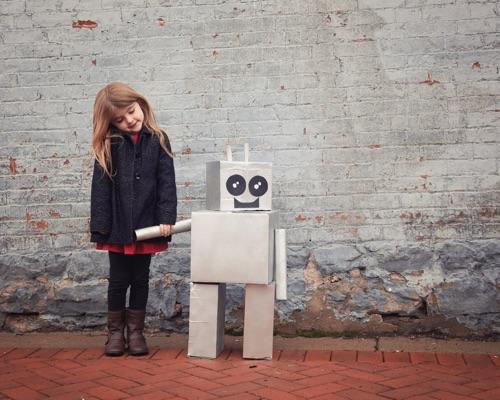 Little girl and robot companion.