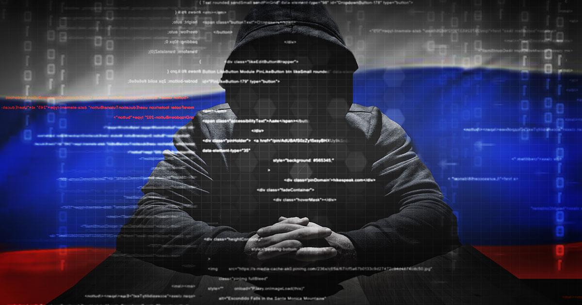 Russian hacker in front of Russian flag