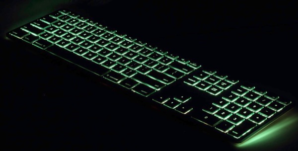 Matias keyboard glamor shot, green backlighting.