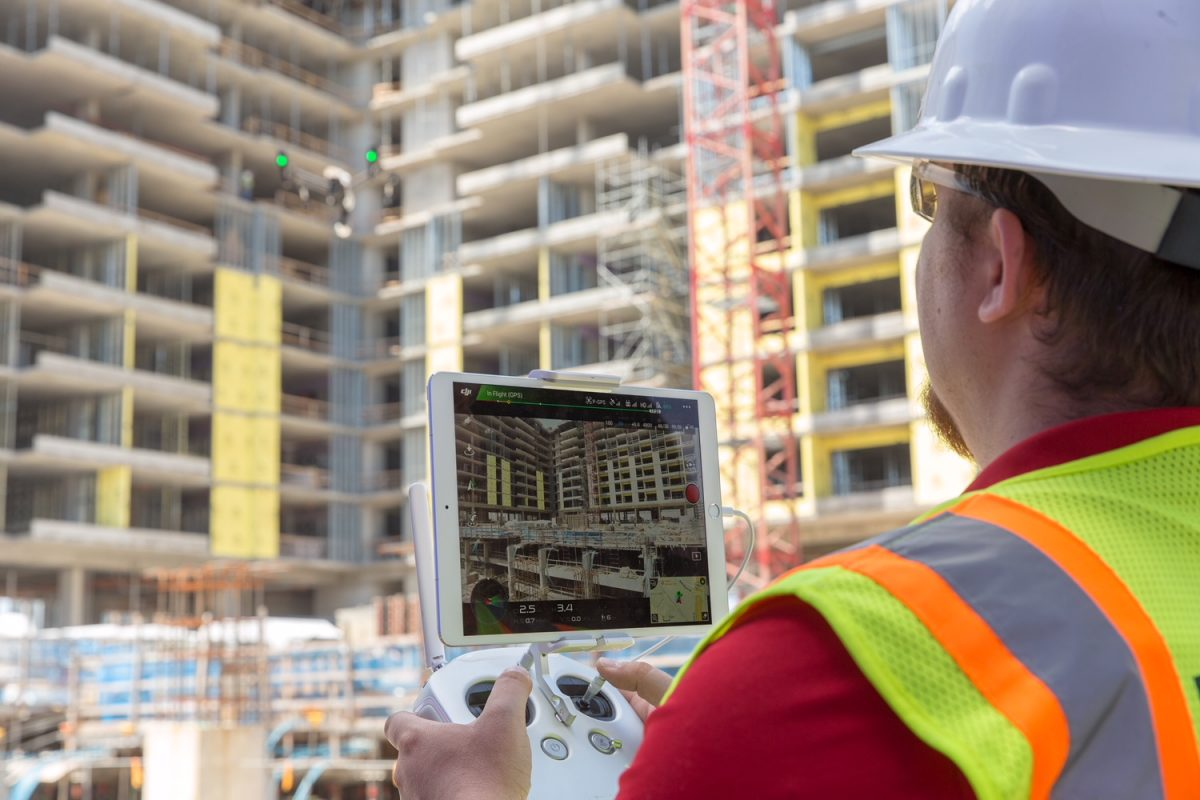 Technician using an iPad at a building site.