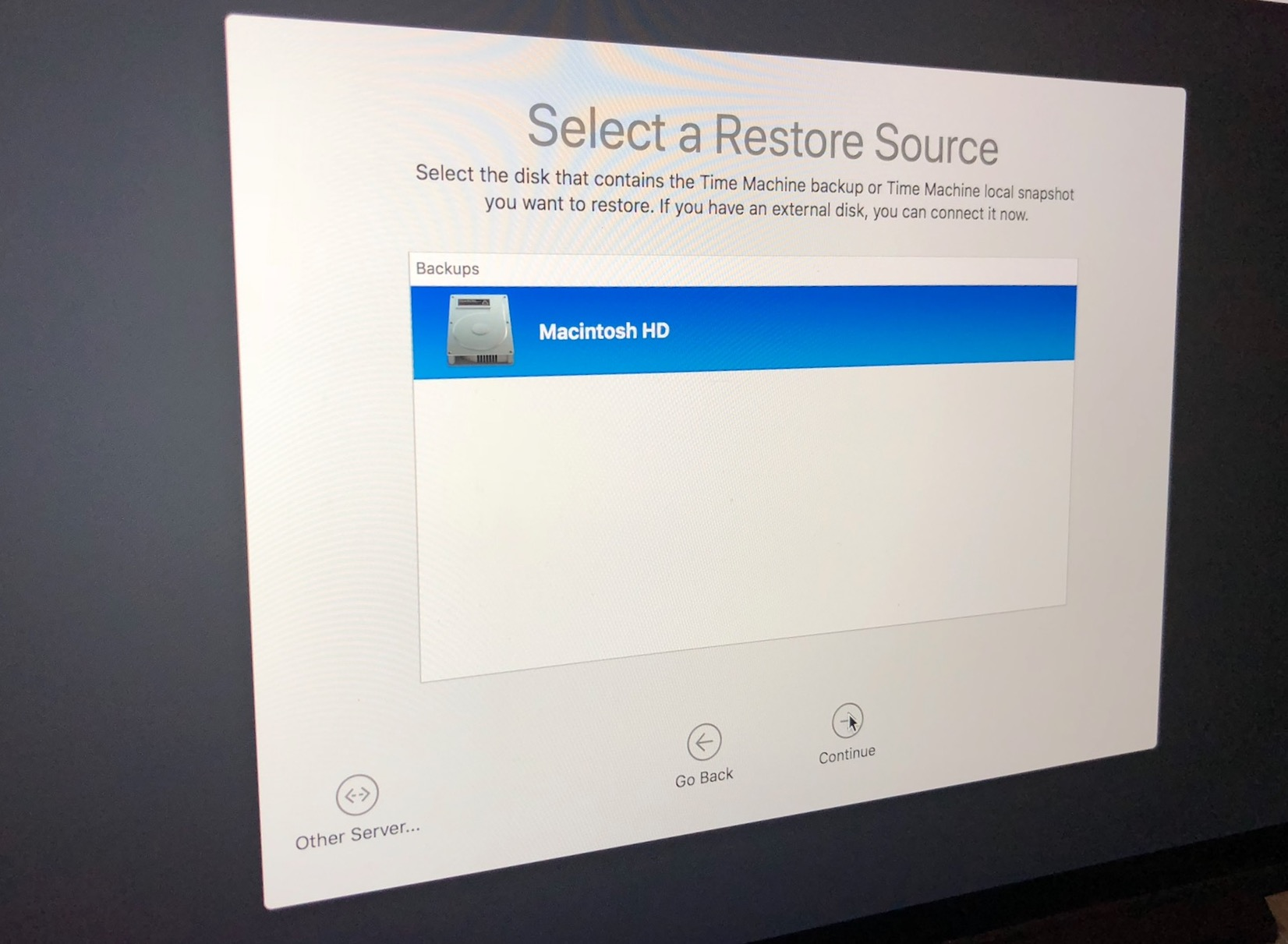 Select a Restore Source in macOS Recovery Mode