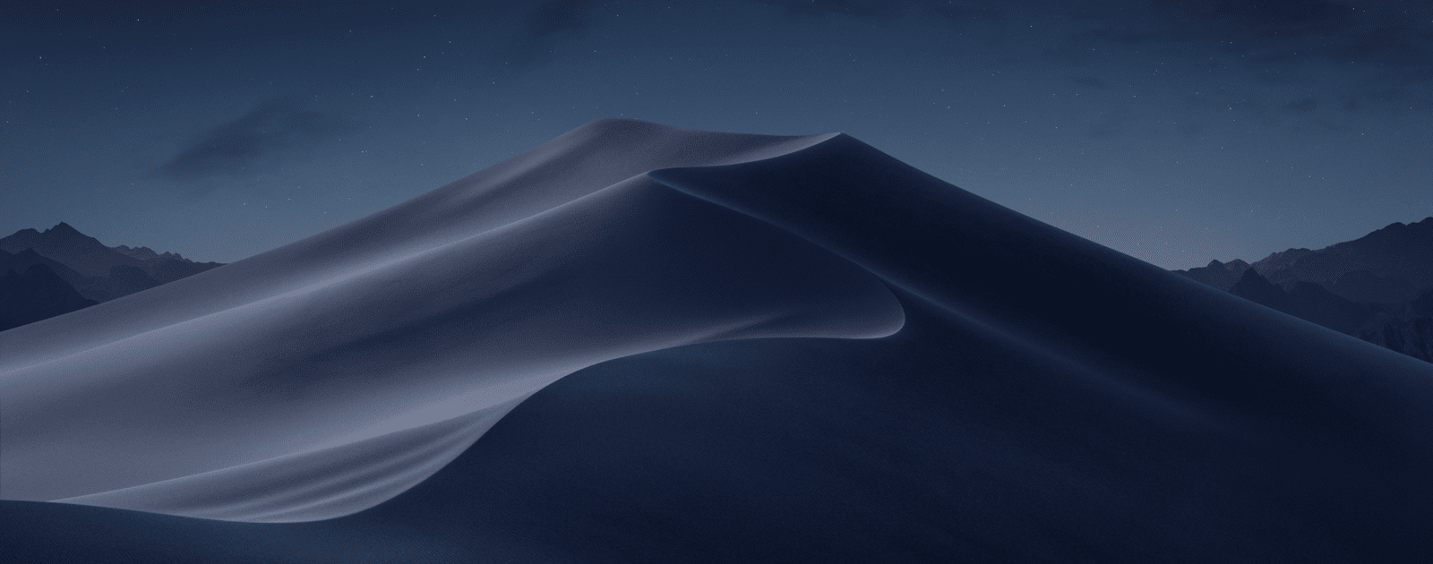 Image of macOS Mojave wallpaper, which has dark mode apps.