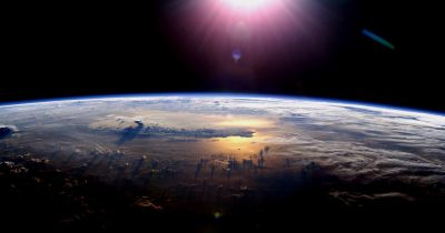 Earth and Sun seen from space.