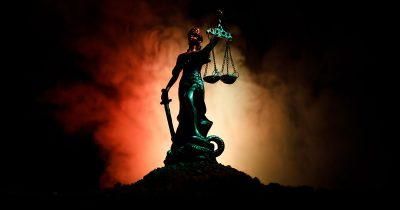 Justice is blind, even if she's teetering on the brink of an apocalyptic wasteland
