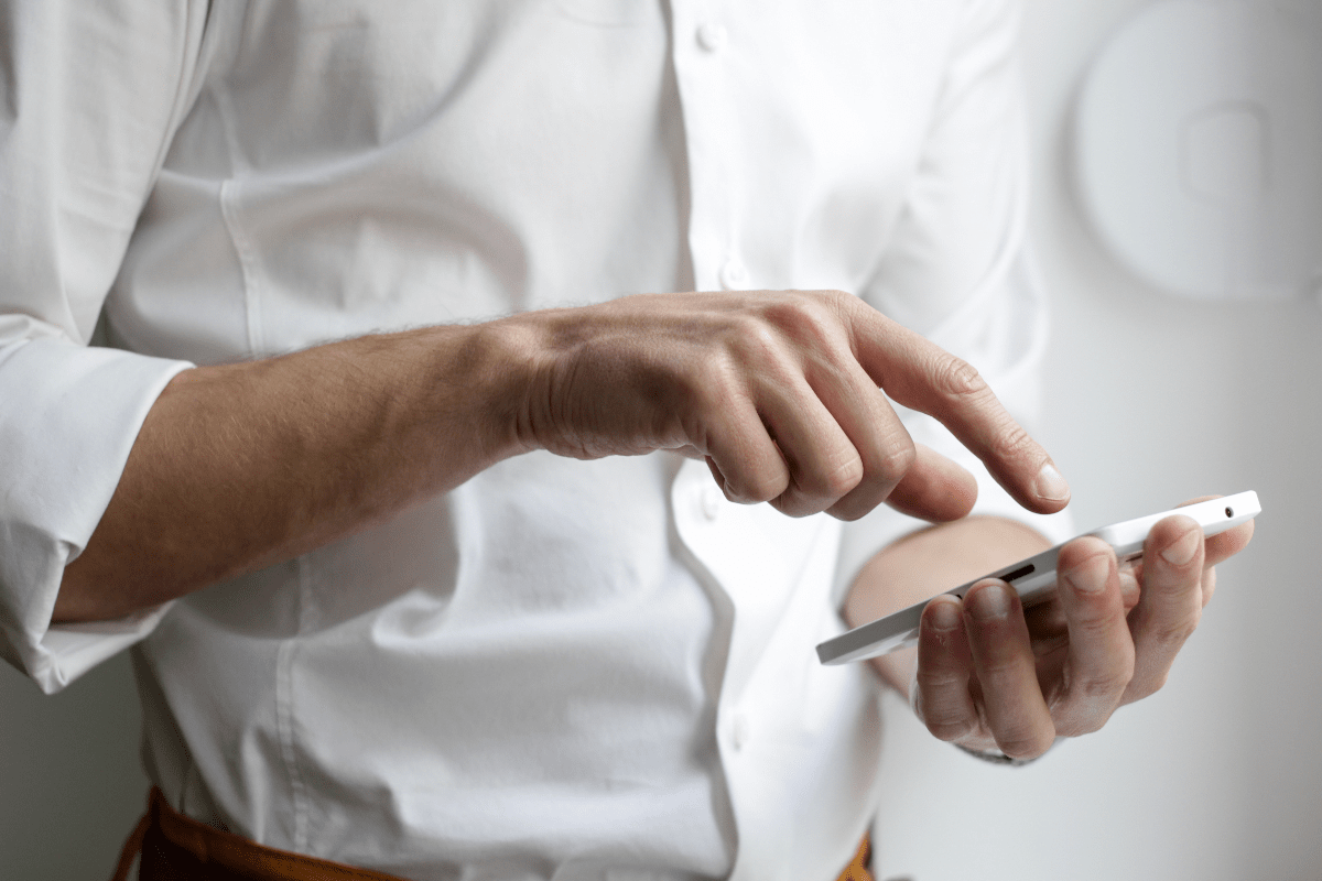 Image of man using a smartphone.