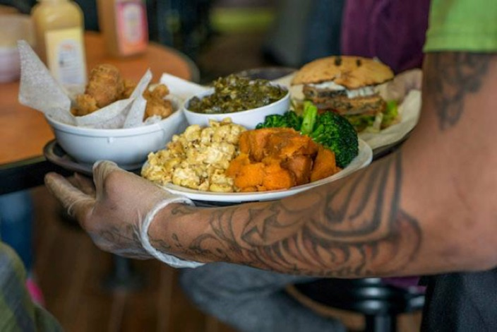 Vegan Food on Tattooed Arm
