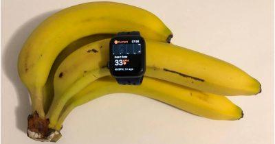 Apple Watch logging heart rate data on a banana