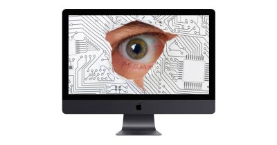 iMac with spy watching through screen