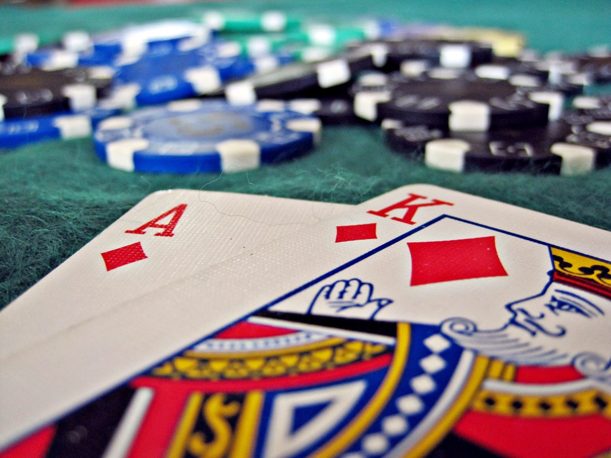 Ace and King of Diamonds with Poker Chips