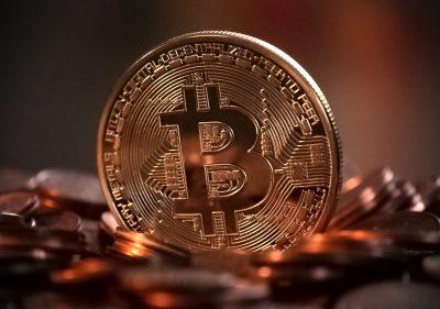 Bitcoin Logo on physical gold coin