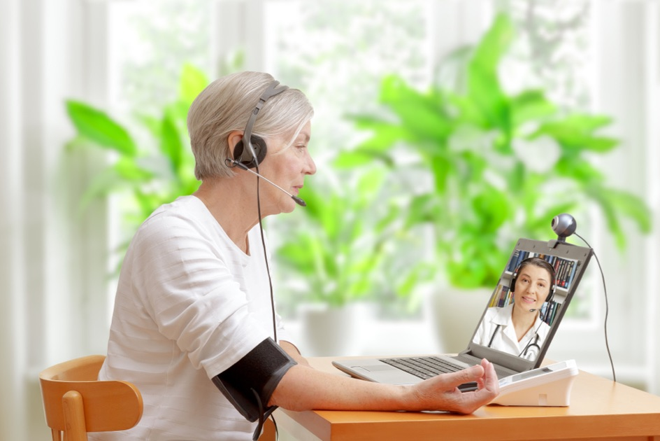 Woman consulting with doctor remotely.
