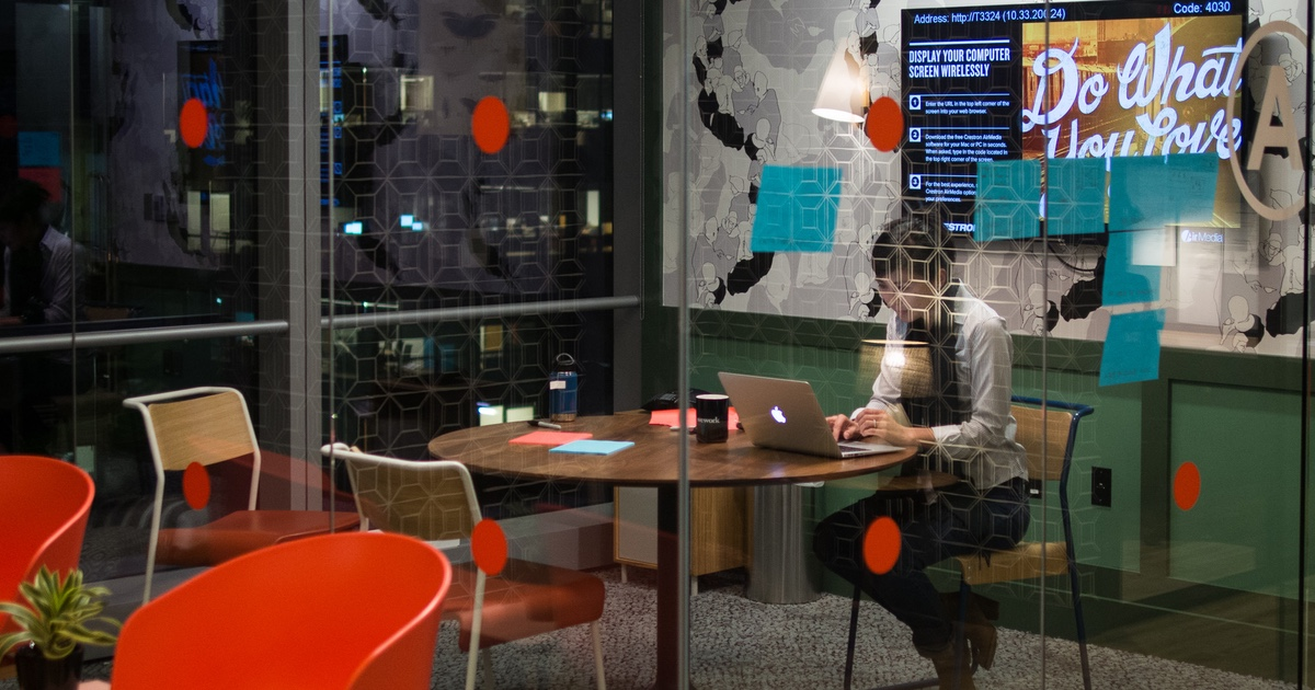 WeWork office with someone typing