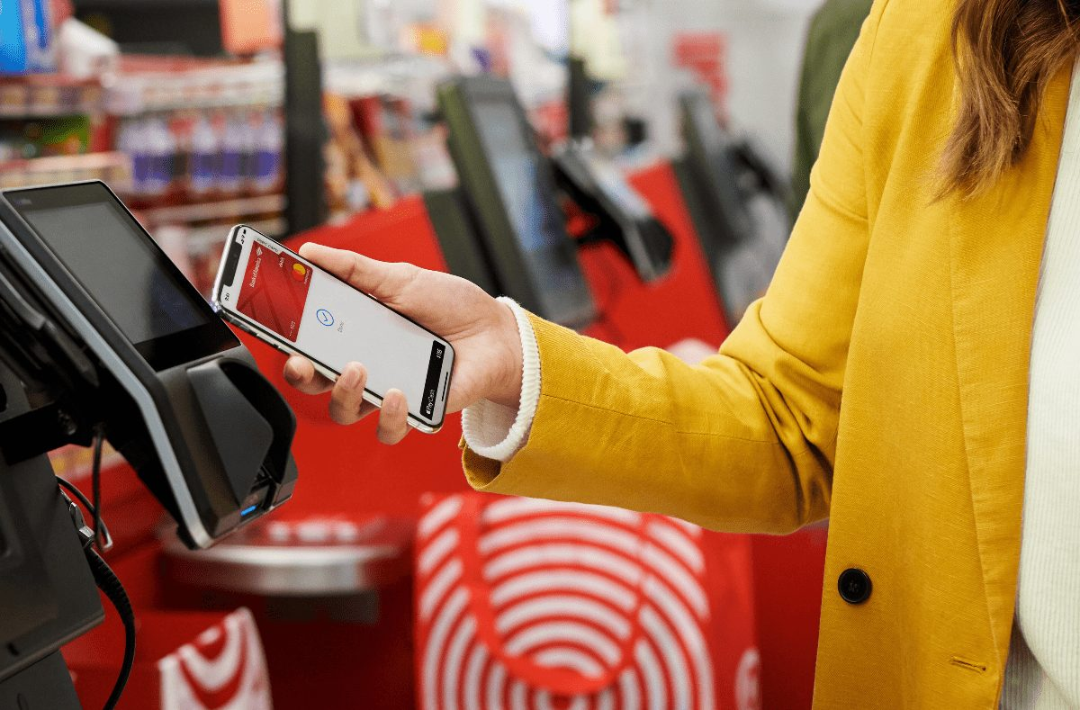 woman using apple pay at target
