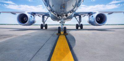 Jet airliner at gate.