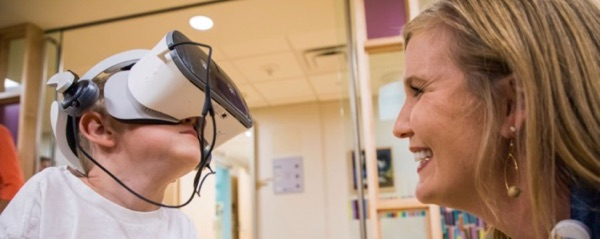 child patient with VR headset.