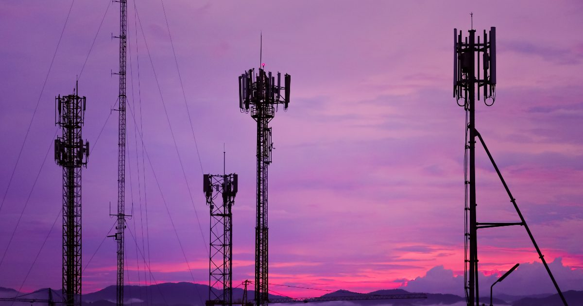 cell towers on a purple sky