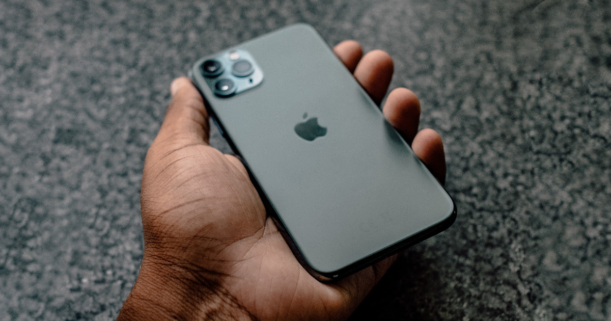 Man holding a green iPhone 11