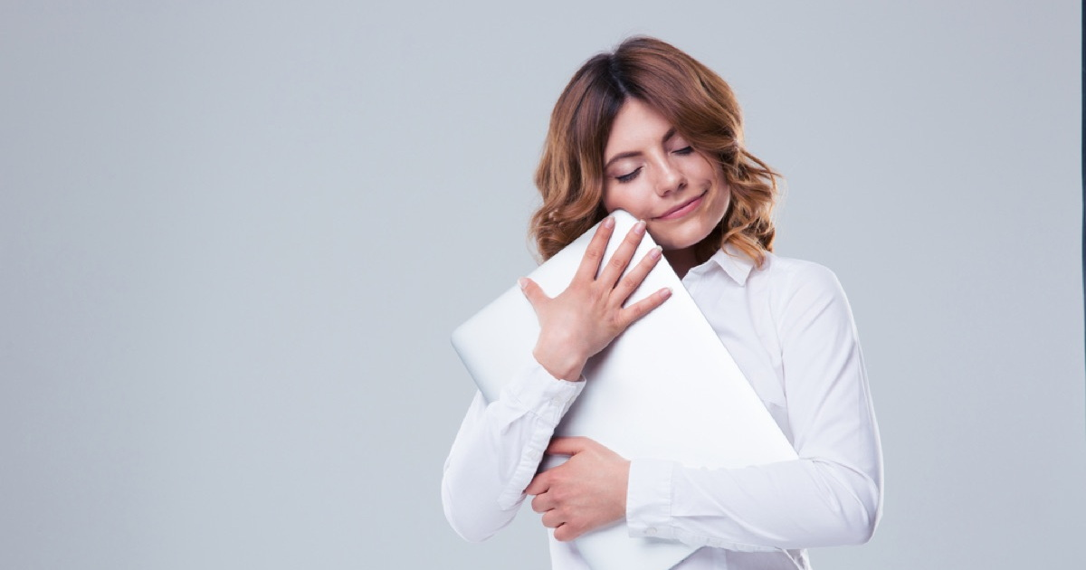 woman hugging computer