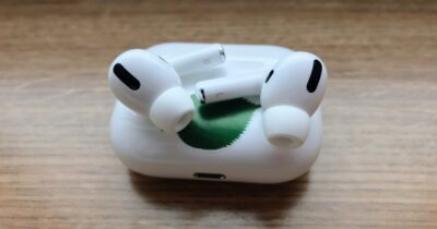 Image of AirPods Pro on top of case.