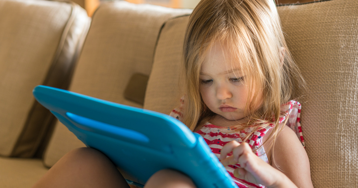 Toddler playing on iPad